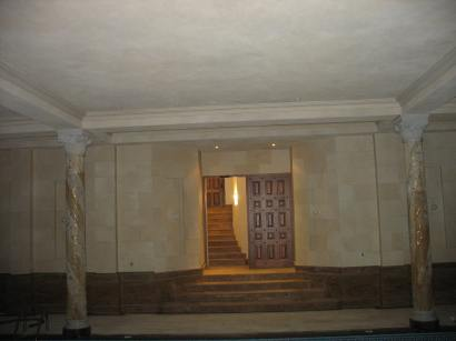 Faux limestone plaster wall in indoor pool area