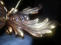 Gilt chandelier detail.