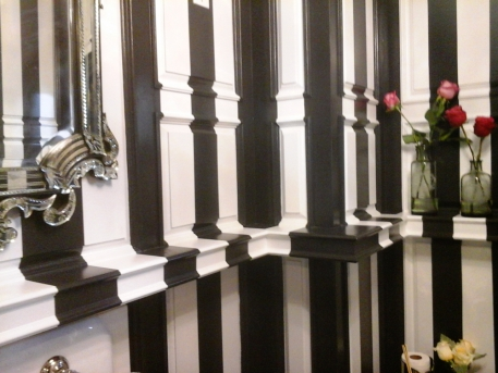 Painted stripe finish on an intricate paneled wall_detail