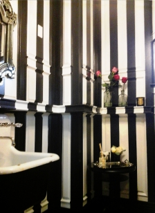 Hand painted stripe finish on an intricate paneled wall